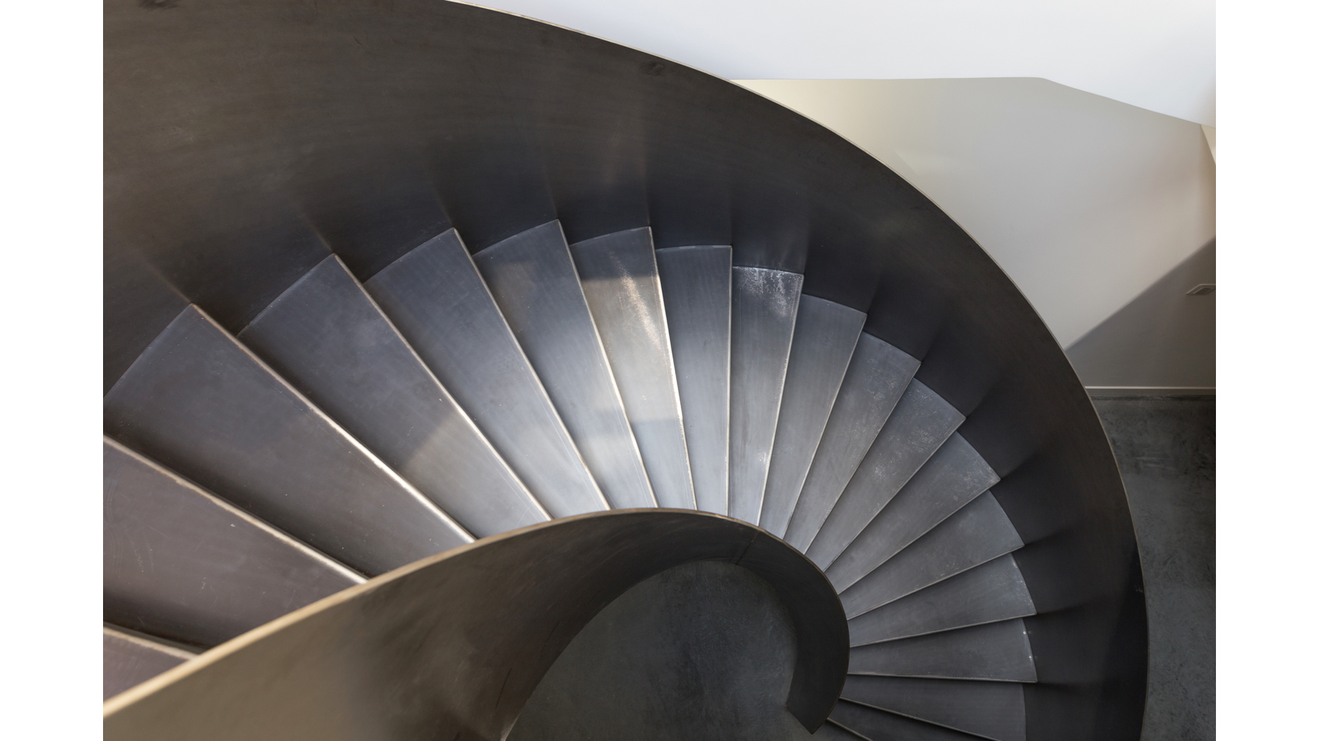 Curved Raw Steel Staircase iv | © Bernardo Guillermo Studio